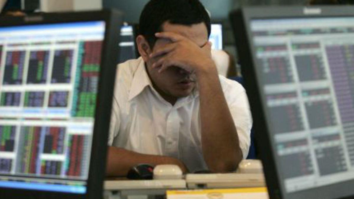 Photo d'un trader (source: lexpress)