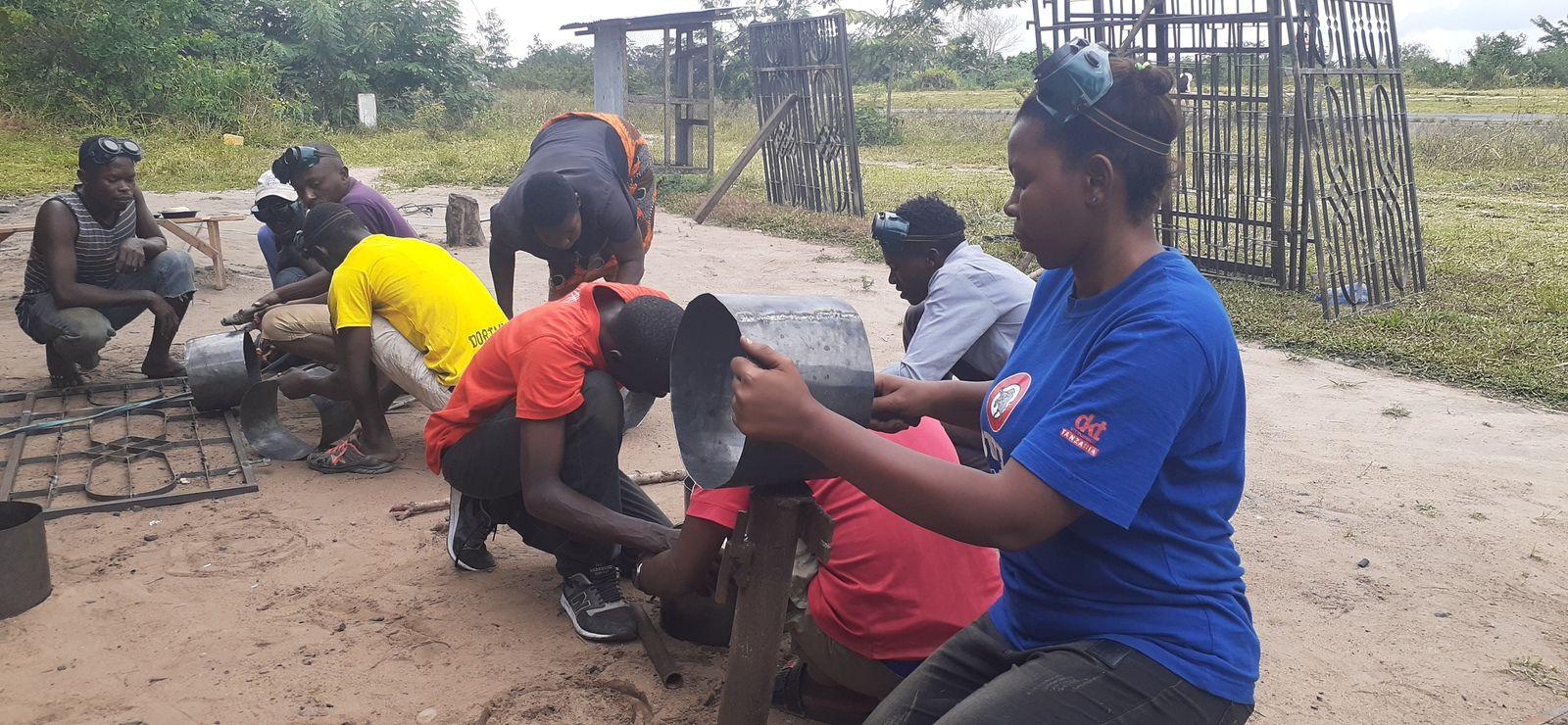 Youth  pioneer fabricating energy saving stoves in Kidomole village, Bagamoyo