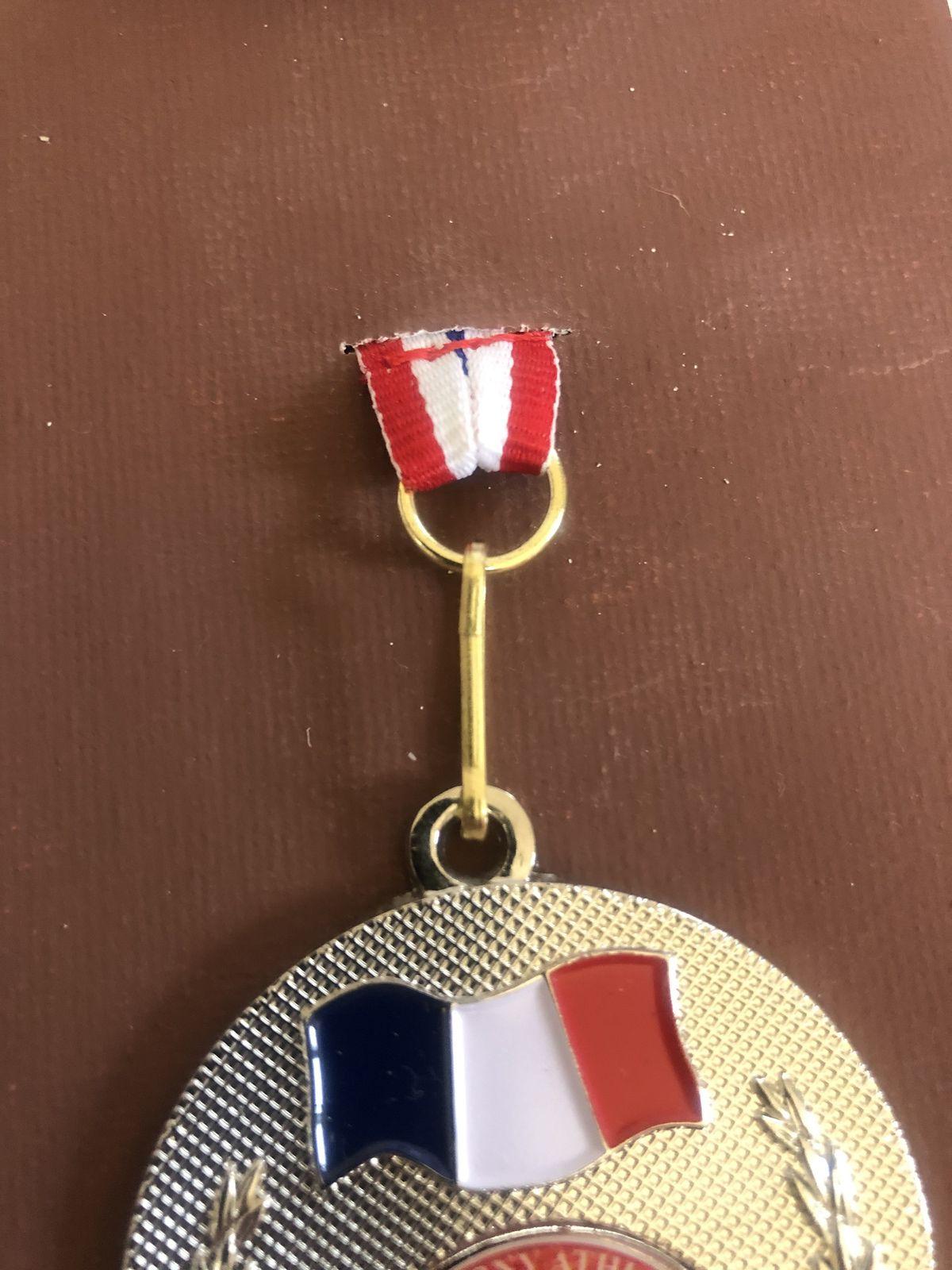 Toile de médailles de cross