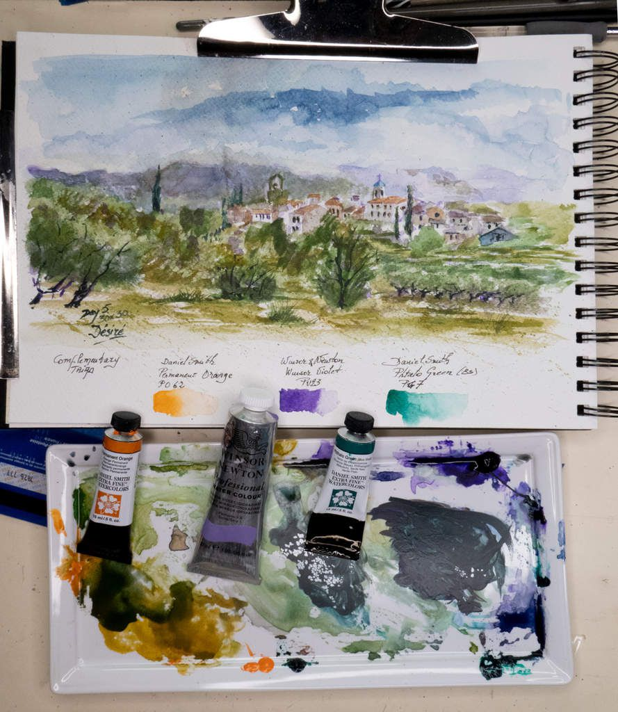 View of my workspace with mixing palette with the secondary triad, to create the painting of Lourmarin