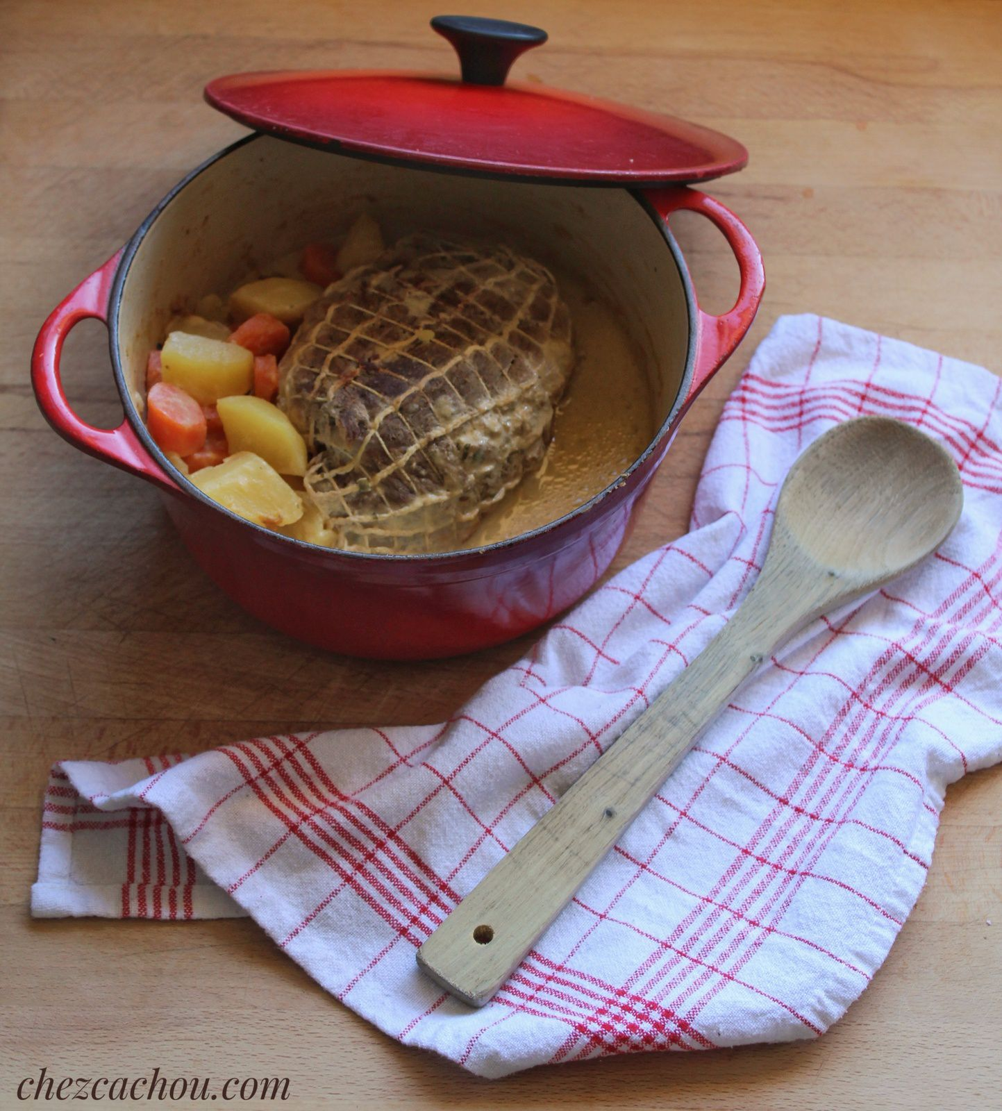 Rôti de porc au fromage ail et fines herbes