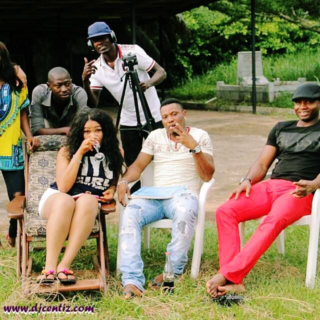 Joy and HT Films Crew on location sitting by Horesh Thomas (R).