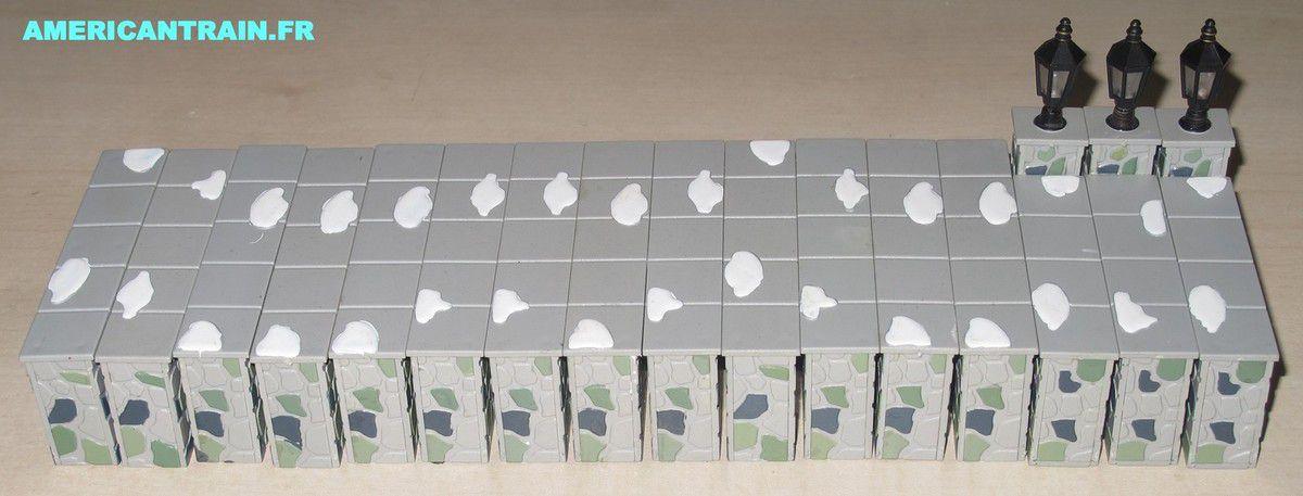 Murets en pierre et éclairage échelle O K-line