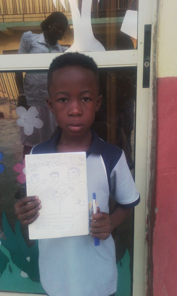 Here is Ayomikun with his invented pen and Exercise Book