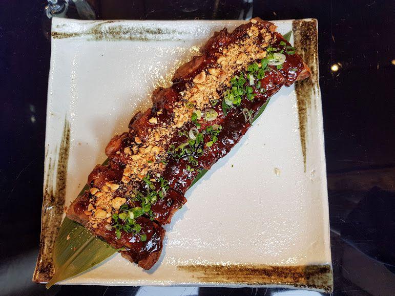 Travers de porc fondant, sauce au poivre noir, cébette Ran Restaurant Paris 8