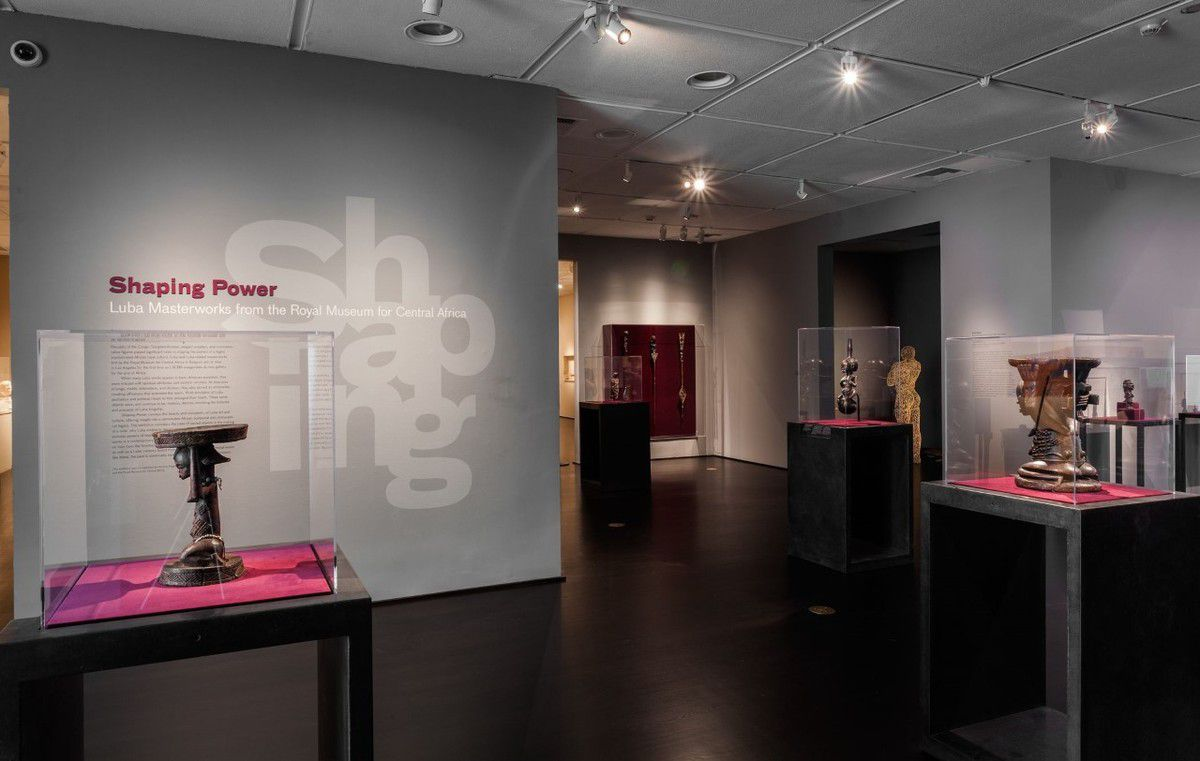 "Fig 9. ""Shaping Power"" exhibition at LACMA, 2013-2014, with Aimé Mpane's ""Congo: Shadow of the Shadow"" in the background. Photo with permission."