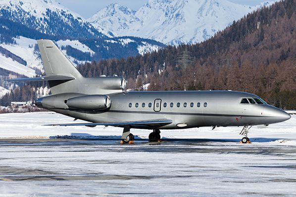 Dassault Falcon 900 snowy mountains