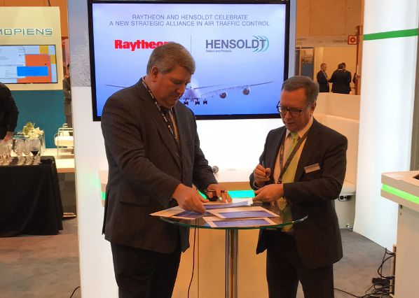 Successful partnership: Bob Delorge, vice president of transportation and support services at Raytheon Intelligence, Information and Services (left), and Erwin Paulus, Head of Radar, IFF and Communications at HENSOLDT, signing the partnership agreement exactly one year ago.           Photo: HENSOLDT