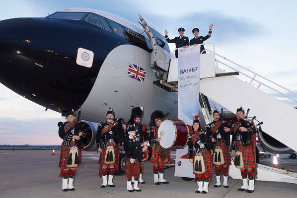 Inverness pipe band the British Airways Captain Stuart Wittke and First Officer Benjamin Wilson