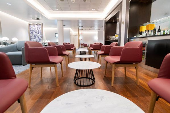 linate lounge red armchairs