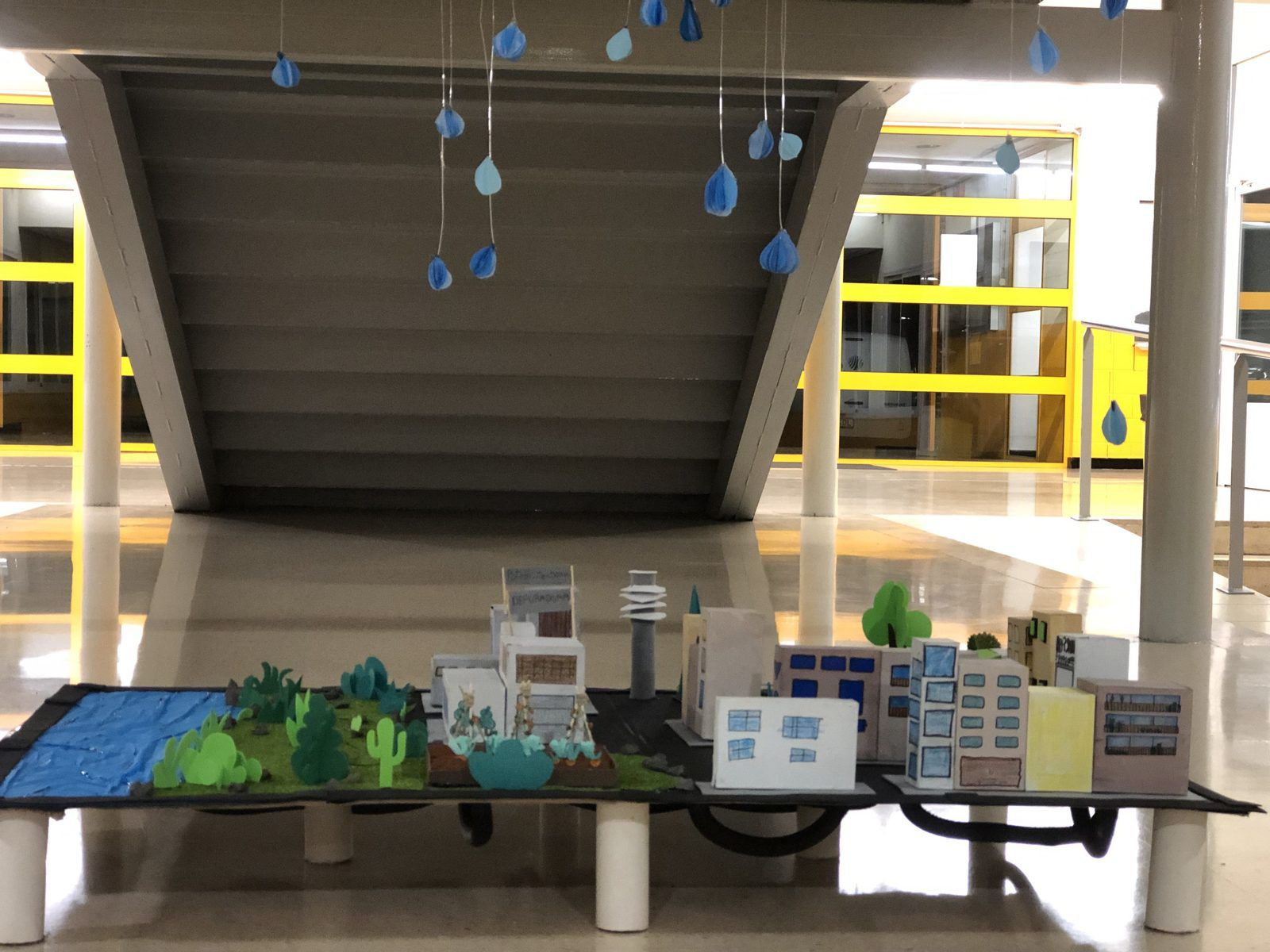 Model of the water cycle created by Martí Dot students exposed in the high school hall
