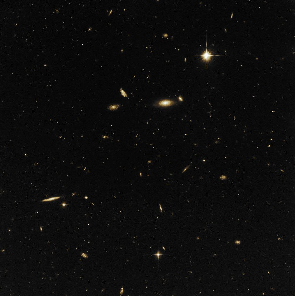 A sea of galaxies (NASA, ESA & M. Mutchler (STScI), CC BY 4.0)