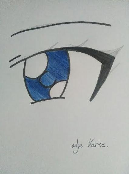 Dessin manga effectué à la main : un oeil bleu