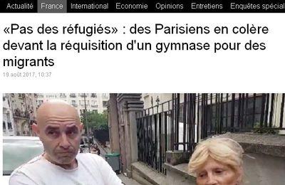 «Pas des réfugiés» : des Parisiens en colère devant la réquisition d'un gymnase pour des centaines de migrants évacués du campement de la Porte de la Chapelle ont été transférés dans un centre sportif, réquisitionné et aménagé en toute discrétion les jours précédents (videos media fr)